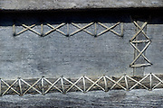 Detail of the side of a boat. These boats, are sewn together and sometimes have old copper coins as rivets.<br /> Copyright: Dominic Sansoni