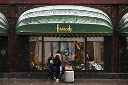 © Licensed to London News Pictures. 26/02/2018. London, UK. Snow settles on the awning outside Harrods in Knightsbridge, West London. Severe cold, blizzards and heavy snow are expected as the 'Beast from the East' brings freezing Siberian air to the UK. Photo credit: Rob Pinney/LNP