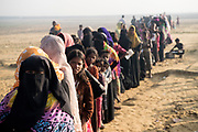 9th November 2017. Rohingya refugees line up and wait their turn to receive food at the Nayapara Distribution Point. Often described as the &quot;world's most persecuted minority&quot;. The Rohingya are a Muslim ethnic group from the Rakhine State in Myanmar.<br /> <br /> In October 2016, a military crackdown in the wake of a deadly attack on army posts sent hundreds of thousands of Rohingya fleeing to neighboring Bangladesh. Similar attacks in August 2017 led to the ongoing military crackdown, which has led to a new mass exodus of Rohingya. <br /> <br /> So far more than 650,000 people have fled into Bangladesh, swelling the refugee camps and creating a humanitarian crisis. Photograph by David Dare Parker