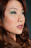Beautiful Chinese woman with makeup looking away