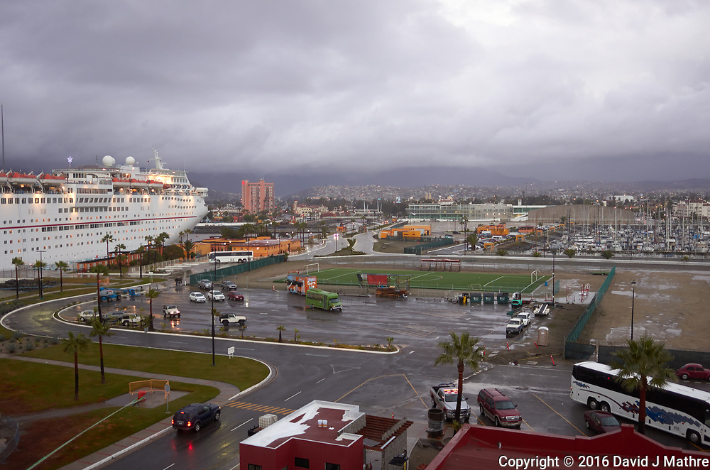 "(Image three of nine) Panorama of the Ensenada harbor in Mexico on a grey and raining day from the deck of the MV World Odyssey. The other cruse ship is the Carnival Imagination. Once all of the students, faculty, staff, and life long learners were aboard we would be ready to begin the 102 day ""round the world"" Semester at Sea Spring 2016 Voyage. Composite of nine images taken with a Leica T camera and 23 mm f/2 lens (ISO 250, 23 mm, f/2, 1/80 sec). Panorama stitched using AutoPano Giga Pro."