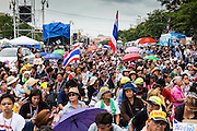 24 NOVEMBER 2013 - BANGKOK, THAILAND: Crowds on Rathdamnoen Ave in Bangkok Sunday. More than 400,000 people packed onto Ratchdamnoen Ave in Bangkok Sunday, continuing an anti-government protest that started weeks ago over a blanket amnesty bill passed by the Thai Parliament. The amnesty bill was defeated in the Thai Senate and the protest morphed into a general protest against the government. The protestors are allied with the Thai Democrat party, the opposition party in parliament. Tens of thousands of pro-government Red Shirts have come to Bangkok to defend the government and are rallying in a different part of the city. Police have warned of clashes between the two groups but as of Sunday evening no problems had been reported. The protestors allege that the amnesty would allow fugitive former Prime Minister Thaksin Shinawatra to return to Thailand.        PHOTO BY JACK KURTZ