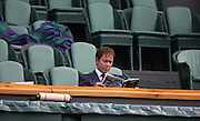 30/06/2011 - Wimbledon (Day 10) - Sir Cliff Richard sits alone in the Royal Box reading the programme - Photo: Simon Stacpoole / Offside.
