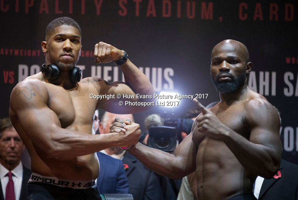27.10.17 - Joshua v Takam, Weigh In, Cardiff - Anthony Joshua and Carlos Takam during the weigh in at the Motorpoint Arena ahead of their World Heavyweight Championship fight at the Principality Stadium on the 28th October 2017.<br /> Copyright photo: Gareth Everett / www.photosport.nz