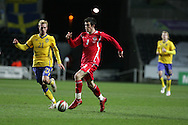 Gareth Bale of Wales goes past Sweden's  Christian Wilhelmsson (21). International friendly, Wales v Sweden at the Liberty Stadium in Swansea on Wed 3rd March 2010. pic  by  Andrew Orchard