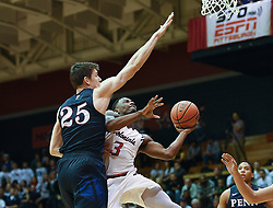 MOON TOWNSHIP, PA - NOVEMBER 11:  Kavon Stewart #3 of the Robert Morris Colonials drives to the basket against AJ Brodeur #25 of the Pennsylvania Quakers in the first half during the game on November 11, 2016, at the Charles L. Sewall Center in Moon Township, Pennsylvania. (Photo by Justin Berl)