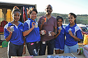 BELLVILLE, SOUTH AFRICA - Wednesday 3 December 2014, The Rhoda family that have been handing out medals for 10 years during the Metropolitan 10km road race outside the Parc Du Cap head office in Bellville.<br /> Photo by IMAGE SA / Roger Sedres
