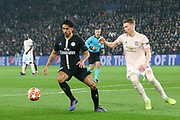 Marquinhos of Paris Saint-Germain battles with Manchester United Midfielder Scott McTominay during the Champions League Round of 16 2nd leg match between Paris Saint-Germain and Manchester United at Parc des Princes, Paris, France on 6 March 2019.
