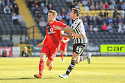 York City forward Reece Thompson battles with Notts County defender Alan Sheehan during the Sky Bet League 2 match between Notts County and York City at Meadow Lane, Nottingham, England on 26 September 2015. Photo by Simon Davies.