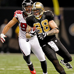 2009 November 02: New Orleans Saints tight end Jeremy Shockey (88) runs after a catch from the pursuit of Atlanta Falcons defensive end Jamaal Anderson (98) during the second quarter at the Louisiana Superdome in New Orleans, Louisiana.
