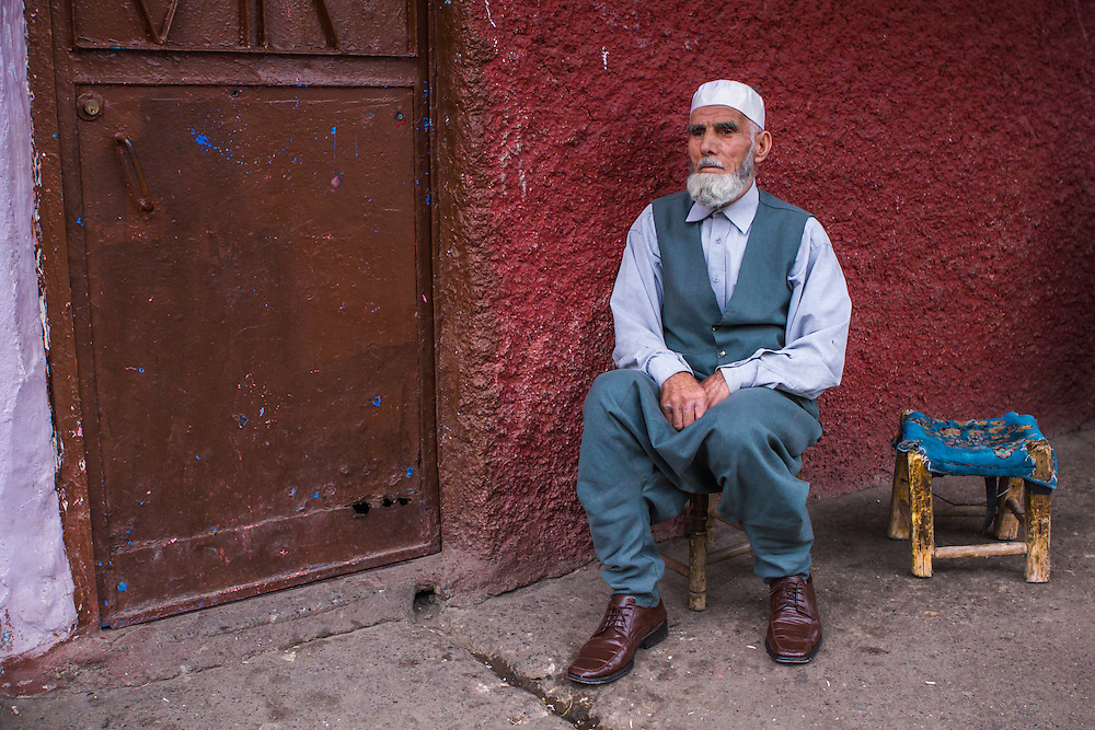 An old Kurdish muslim man sitting in front of his house in the old city of Diyarbakir, southeastern Turkey.<br />