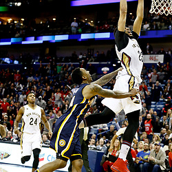 Dec 15, 2016; New Orleans, LA, USA; New Orleans Pelicans forward Anthony Davis (23) dunks over and draws a foul from Indiana Pacers guard Jeff Teague (44) during the fourth quarter of a game at the Smoothie King Center. The Pelicans defeated the Pacers 102-95. Mandatory Credit: Derick E. Hingle-USA TODAY Sports