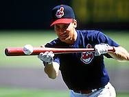 CHICAGO - 1997:  Omar Vizquel of the Cleveland Indians practices his bunting prior to a 1997 MLB game at Jacobs Field in Cleveland, Ohio.  Vizquel played for the Indians from 1994-2004.  (Photo by Ron Vesely)