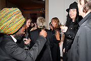 Johnnie Sapong; JONAS ACKURLUND, Harper's Bazaar Women Of the Year Awards 2011. Claridges. Brook St. London. 8 November 2011. <br /> <br />  , -DO NOT ARCHIVE-© Copyright Photograph by Dafydd Jones. 248 Clapham Rd. London SW9 0PZ. Tel 0207 820 0771. www.dafjones.com.