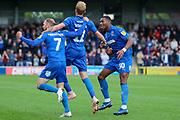 AFC Wimbledon midfielder Mitchell (Mitch) Pinnock (11) celebrating after scoring goal with AFC Wimbledon midfielder Scott Wagstaff (7) and AFC Wimbledon defender Paul Kalambayi (30) during the EFL Sky Bet League 1 match between AFC Wimbledon and Rochdale at the Cherry Red Records Stadium, Kingston, England on 5 October 2019.