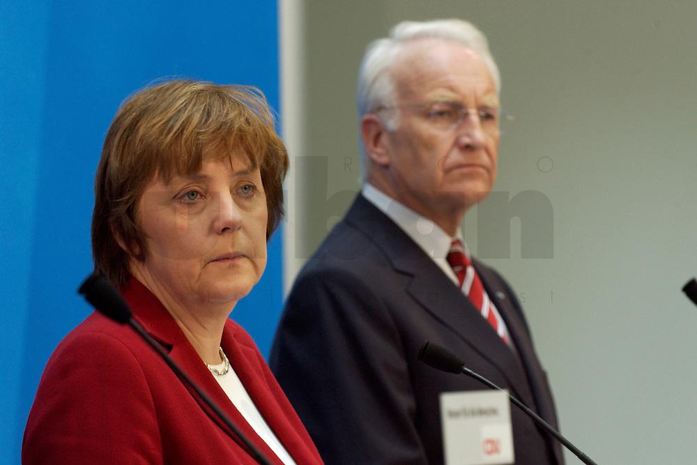 02 APR 2004, BERLIN/GERMANY:<br /> Angela Merkel (L), CDU Bundesvorsitzende, und Edmund Stoiber (R), CSU, Ministerpraesident Bayern, waehrend einem Pressestatement zu dem vorangegangenem europapolitischen Spitzengespraech von CDU und CSU, Konrad-Adenauer-Haus<br /> IMAGE: 20040402-02-012<br /> KEYWORDS: Ministerpr&auml;sident, CDU Bundesgeschaeftsstelle