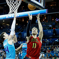 01 November 2015: Atlanta Hawks forward Tiago Splitter (11) goes for the layup past Charlotte Hornets center Frank Kaminsky III (44) during the Atlanta Hawks 94-92 victory over the Charlotte Hornets, at the Time Warner Cable Arena, in Charlotte, North Carolina, USA.