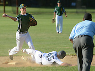 LANGHORNE, PA - JUNE 27:  Newtown's Brendan  Campbell tries for the double play after forcing out Yardley Western's Jack Siebert #45 during the Newtown vs. Yardley Western Legion baseball game at Cairn University June 27, 2014 in Langhorne, Pennsylvania.  (Photo by William Thomas Cain/Cain Images)