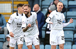Dundee's Kenny Miller (right) celebrates scoring his side's first goal of the game with team-mates during the Scottish Premiership match at Dens Park, Dundee.