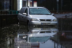 © Licensed to London News Pictures. 22/11/2016. Rotherham, UK. An abandoned car is submerged on a flooded road in Rotherham, South Yorkshire, after a river broke it's banks last night. Storm Angus has brought heavy wind and rain to much of the UK this week with flooding seen all over. Photo credit : Ian Hinchliffe/LNP
