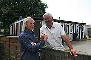 Jim saying hello to one of his neighbour on the Exacalibur Estate, where there are 187 prefabs.