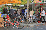 A busy felafel stall at the twice-weekly Turkish market on Maybachufer beside the Landwehrkanal, Berlin, Germany. Picture by Manuel Cohen