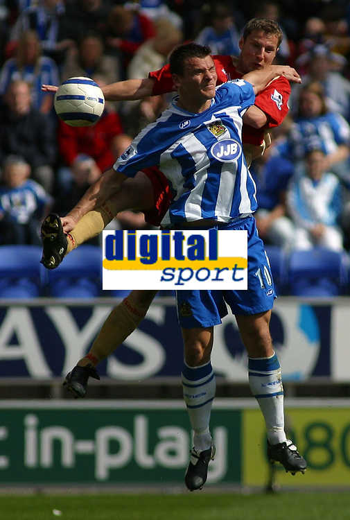 Photo: Paul Thomas.<br />Wigan Athletic v Portsmouth. The Barclays Premiership. 29/04/2006.<br /><br />Wigan's Lee McCulloch tries to win the ball from the Portsmouth defender Brian Priske.