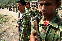 Maoist rebels of the People?s Liberation Army stand guard in a remote part of western Nepal on June 22, 2006. The ten-year old conflict in Nepal has claimed an estimated 13,000 lives. (Photo/Scott Dalton)