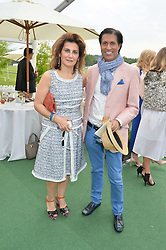 MONA KHASHOGGI and ALEXANDER BARANI at the St.Regis International Polo Cup at Cowdray Park, Midhurst, West Sussex on 17th May 2014.