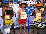 03 SEPTEMBER 2013 - BANGKOK, THAILAND:  A group of farmers dressed in their underwear picket the office of the Thai Prime Minister at Government House to protest the price of cooking gas. The Thai government raised the price of Liquified Propane Gas (LPG - cooking gas) by 50 satang per kilogram (about 1.5 cents US) over the weekend. The price of electricity and highway tolls also went up on the same day dealing most Thais a triple blow. The Thai consumers foundation has filed a suit in Thai administrative courts to block the increase but the courts have not yet ruled on the case. About 50 people protested the price hike at Government House in Bangkok and delivered a letter outlining their objections to a representative of the Prime Minister.      PHOTO BY JACK KURTZ