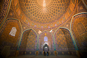 Under the main dome of the extravagently tiled and decorated private mosque Sheikh Lotfollah Mosque, Isfahan, Iran. (Also referred to as Emam Square).  (Imam Square is also called Naghsh-i Jahan Square).
