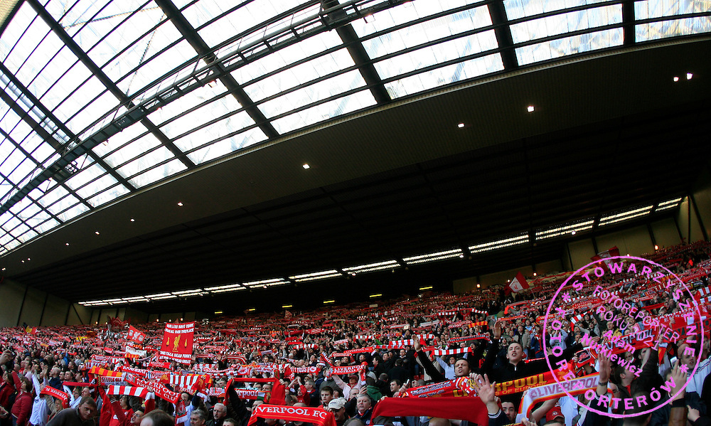 "Liverpool fans at the Kop End sing their traditional ""You'll Never Walk Alone"" anthem"