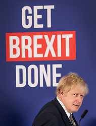 © Licensed to London News Pictures. 29/11/2019. London, UK. Prime Minister Boris Johnson arrives on stage at a press conference in central London. Later a seven way TV election debate will take place with senior politicians in Cardiff. Photo credit: Peter Macdiarmid/LNP