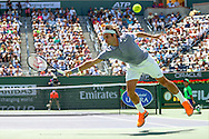 Indian Wells, CA - Roger Federer of Switzerland jumps at a return of serve during the BNP Paribas Open in Indian Wells on day ten against Alexandr Dolgopolov of Ukraine.