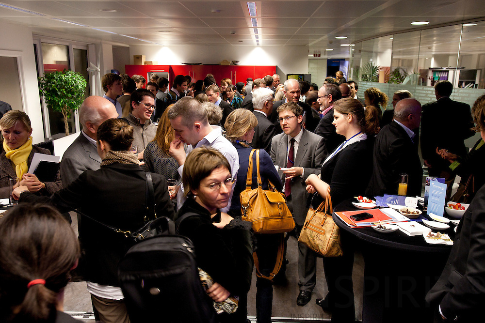 Networking after the EWEA Debate meeting on Achieving 30% lower emissions in the EU: the role of wind energy & other renewables at the EWEA office in Brussels 8 November 2011. Photo: Erik Luntang/INSPIRIT
