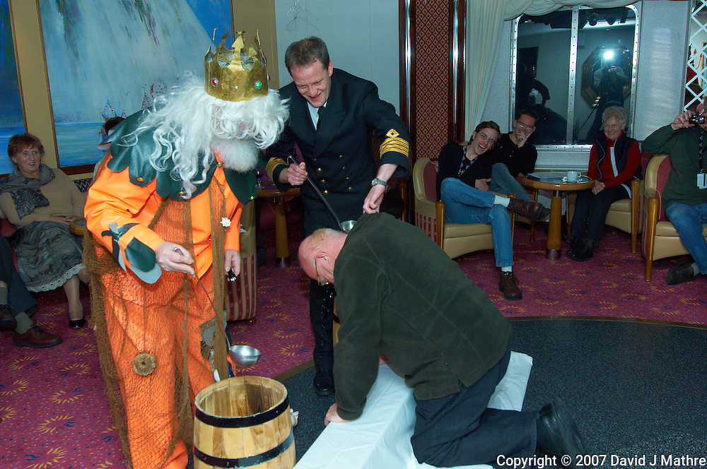 King Neptune and the Ship Captain Performing a Baptism at the Crossing the Artic Circle Ceremony. Image taken with a Nikon D2xs and 12-24 mm f/4 lens (ISO 200, 24 mm, f/6.3, 1/200 sec).