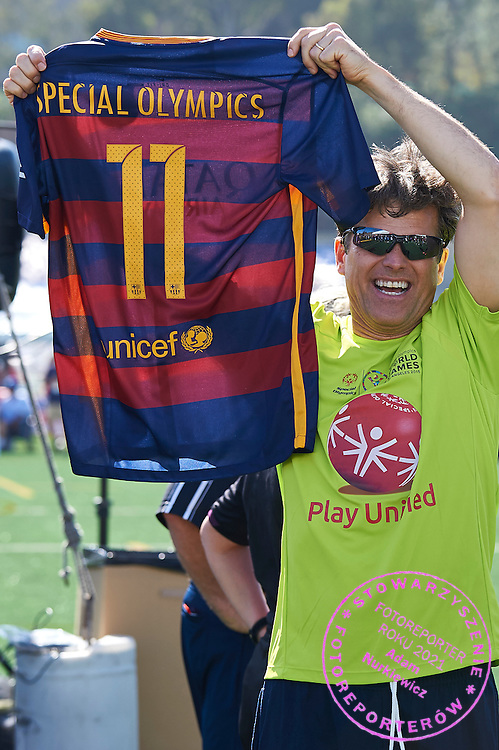 Timothy Shriver presents special edition of t-shirt FC Barcelona while Unified Sports Experience Football 5-a-side match during fourth day of the Special Olympics World Games Los Angeles 2015 on July 28, 2015 at Intramural Fields UCLA (University of California, Los Angeles) in Los Angeles, USA.<br /> <br /> USA, Los Angeles, July 28, 2015<br /> <br /> Picture also available in RAW (NEF) or TIFF format on special request.<br /> <br /> For editorial use only. Any commercial or promotional use requires permission.<br /> <br /> Adam Nurkiewicz declares that he has no rights to the image of people at the photographs of his authorship.<br /> <br /> Mandatory credit:<br /> Photo by &copy; Adam Nurkiewicz / Mediasport
