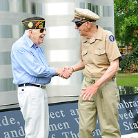 Richard Smart a WW II vet from the Army met for the first time Bill Crawford also a vet from WW II but in the Army Air Corp after the dedication of the new Friendswood Veterans Memorial that was dedicated today.