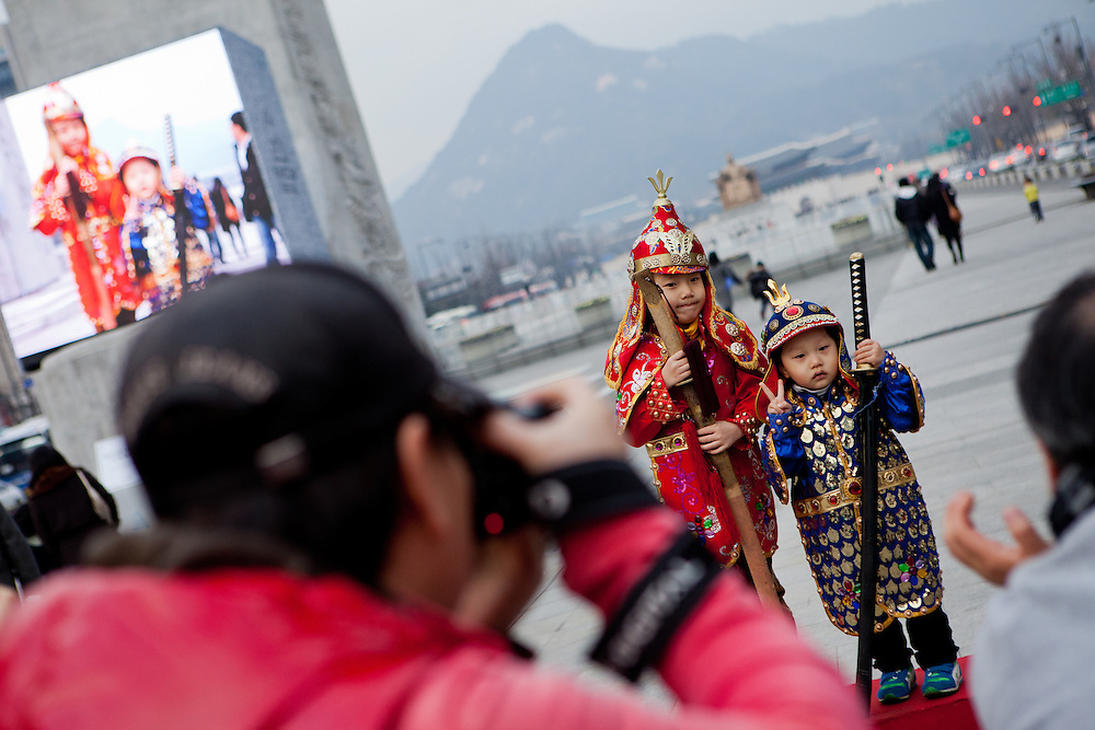 Children in traditional clothes getting photographed at Gwanghwamun Square in the city center of the Korean capital Seoul.