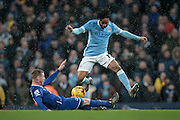 Raheem Sterling (Manchester City) tackled by James McCarthy (Everton) during the Capital One Cup semi-final match between Manchester City and Everton at the Etihad Stadium, Manchester, England on 27 January 2016. Photo by Mark P Doherty.