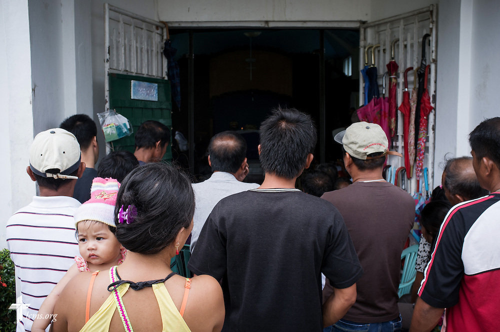 Members crowd outside a packed sanctuary during worship at Christ Lutheran Church in Mahayag, Leyte Province, Philippines, on Sunday, March 16, 2014. LCMS Communications/Erik M. Lunsford