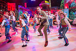 ***Embargoed until 9:40pm***  Repro Free: 28/11/2014<br /> Ryan Tubridy pictured during the opening performance of the RT&Eacute; Late Late Toy Show 2014 with a medley of songs from Chitty Chitty Bang Bang. Picture Andres Poveda