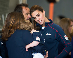 © London News Pictures. 26/07/2015. A young boy looks glum as he meets CATHERINE, Duchess of Cambridge during a visit to Land Rover BAR (Ben Ainslie Racing) in Portsmouth, South Hampshire, as part of a visit to the America's Cup World Series with Prince William. Photo credit: Ben Cawthra/LNP
