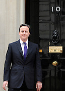 London News pictures. 01.03..2011. David Cameron on the steps of Number 10 Downing Street. British Prime Minister David Cameron meets Afghanistan's President Karzai today (3rd March 2011) in Downing Street, London. Picture Credit should read Stephen Simpson/LNP
