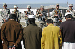 Taliban fighters are handcuffed in Nangarhar province, eastern Afghanistan, on March 2, 2013. Afghan border police captured seven Taliban fighters with their ammunition during a operation in Nangarhar province on Saturday, March 2, 2013. Photo by Imago / i-Images...UK ONLY
