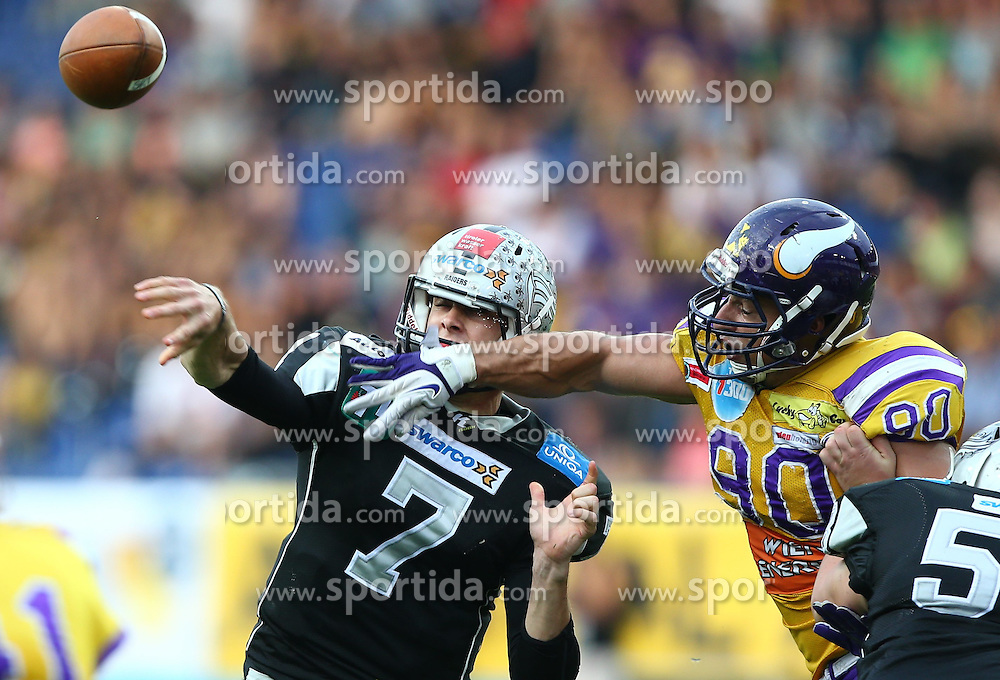 26.07.2014, NV Arena, St. Poelten, AUT, Austrian Bowl XXX, Raiffeisen Vikings Vienna vs Swarco Raiders Tirol, im Bild John Van den Raadt, (Swarco Raiders Tirol, QB, #7) und Alexander Taheri, (Raiffeisen Vikings Vienna, DL, #90) // during the Austrian Bowl XXX between Raiffeisen Vikings Vienna and Swarco Raiders Tirol at the NV Arena, St. Poelten, Austria on 2014/07/26. EXPA Pictures © 2014, PhotoCredit: EXPA/ Thomas Haumer