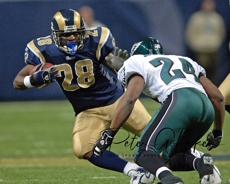 St. Louis Rams running back Marshal Faulk (28) rushes up field against pressure from Philadelphia Eagles linebacker Sheldon Brown (24), during the Eagles 17-16 win at the Edward Jones Dome in St. Louis, Missouri, December 18, 2005.