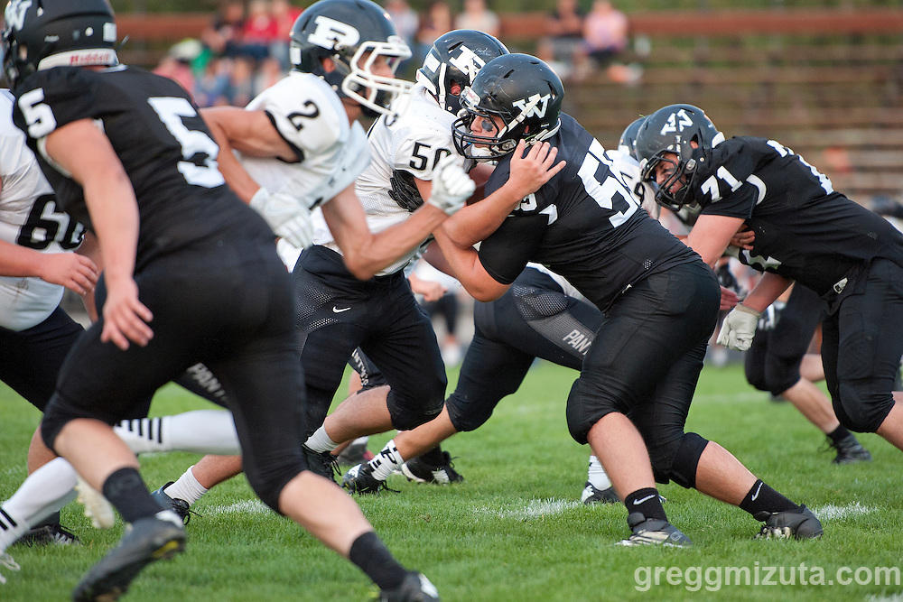 2015 All-state defensive lineman Michael Young (#55), Dawson Eddy (#5) and Wyatt Currey (#71) during Vale's season opening 38-0 win over Parma on September 2, 2016 at Vale, Oregon.