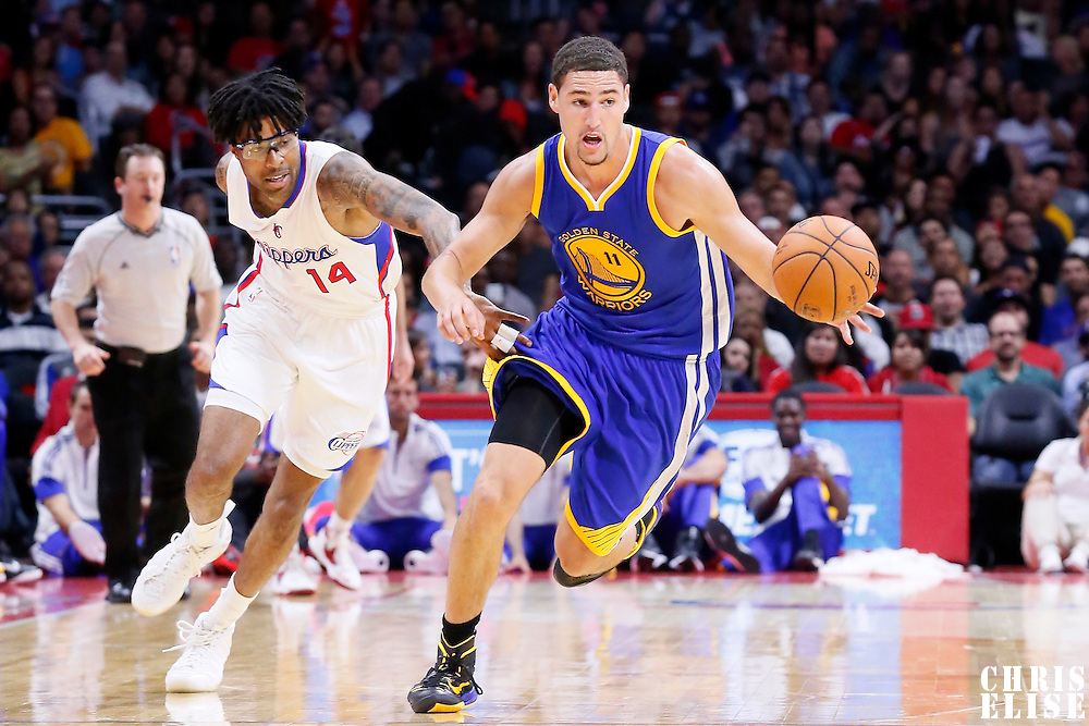 07 October 2014: Golden State Warriors guard Klay Thompson (11) brings the ball up court past Los Angeles Clippers guard Chris Douglas-Roberts (14) during the Golden State Warriors 112-94 victory over the Los Angeles Clipper, in a preseason game, at the Staples Center, Los Angeles, California, USA.