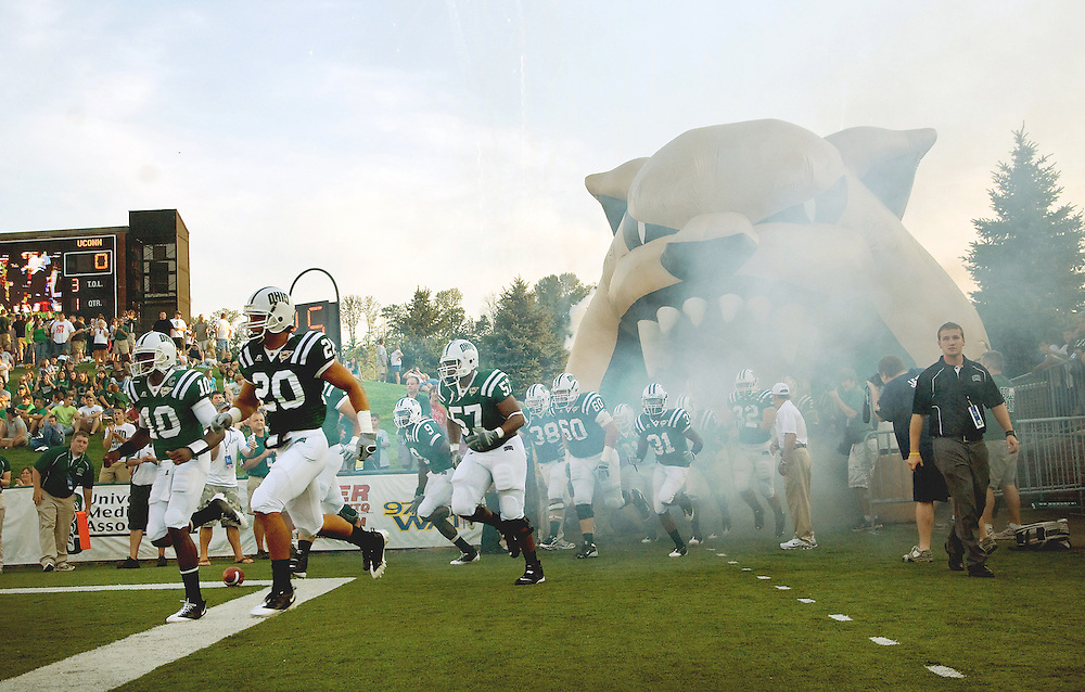 The Ohio University football team runs out on the field before battling the University of Connecticut on Saturday, September 5, 2009.